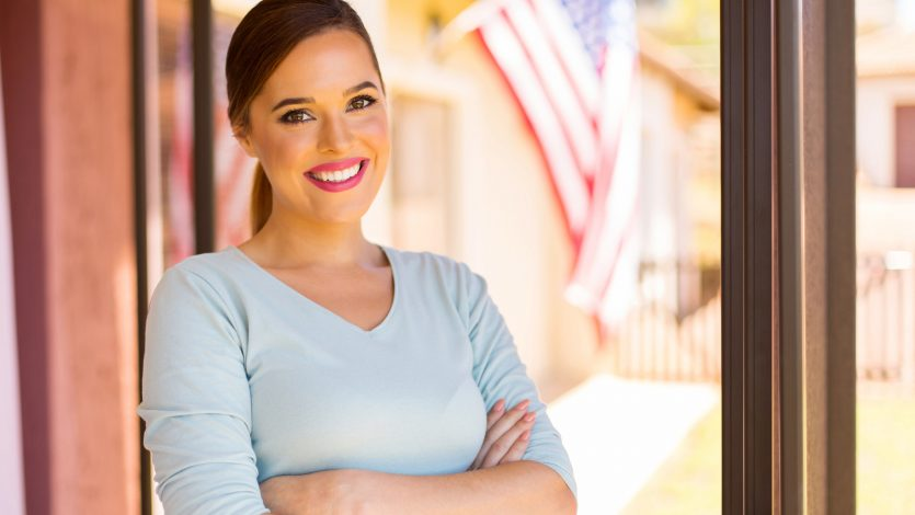 portrait of beautiful young american woman with arms crossed